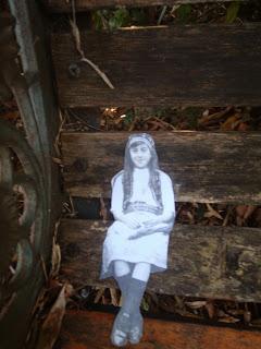 girl+on+bench
